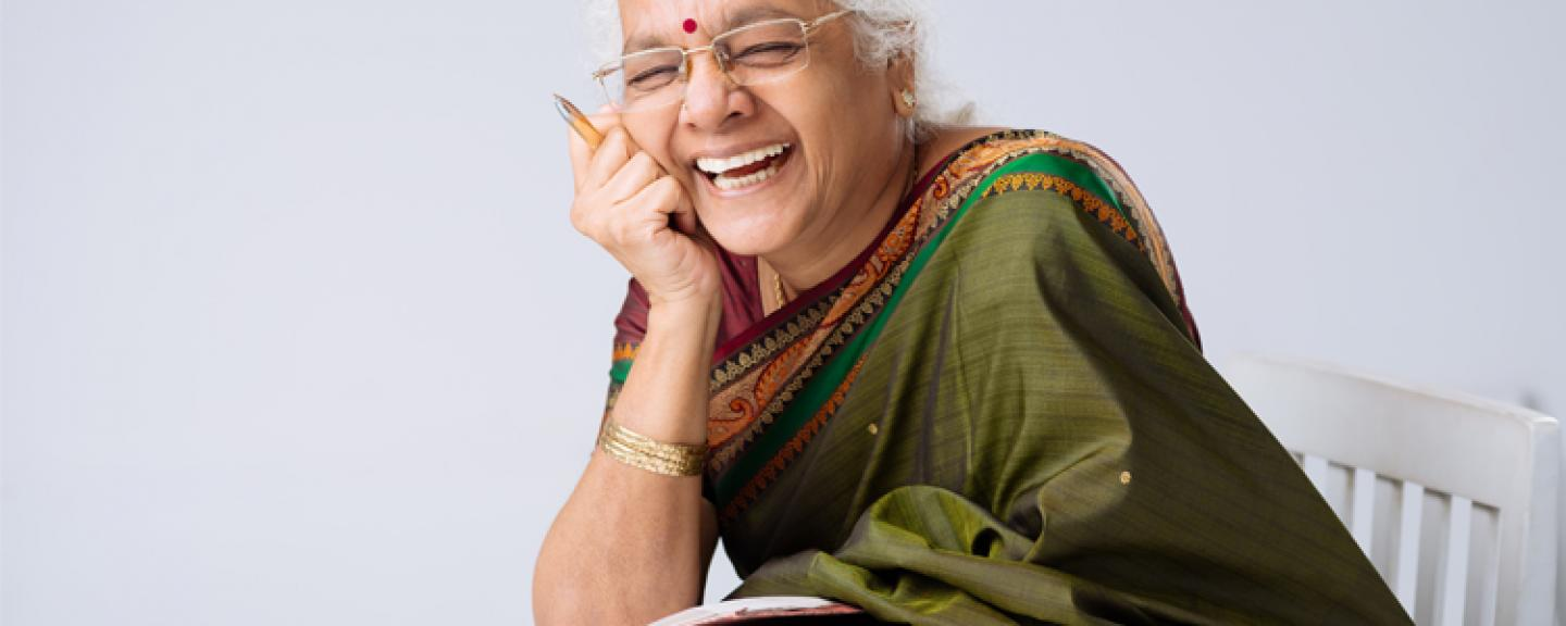 Laughing Indian Woman wearing spectacles