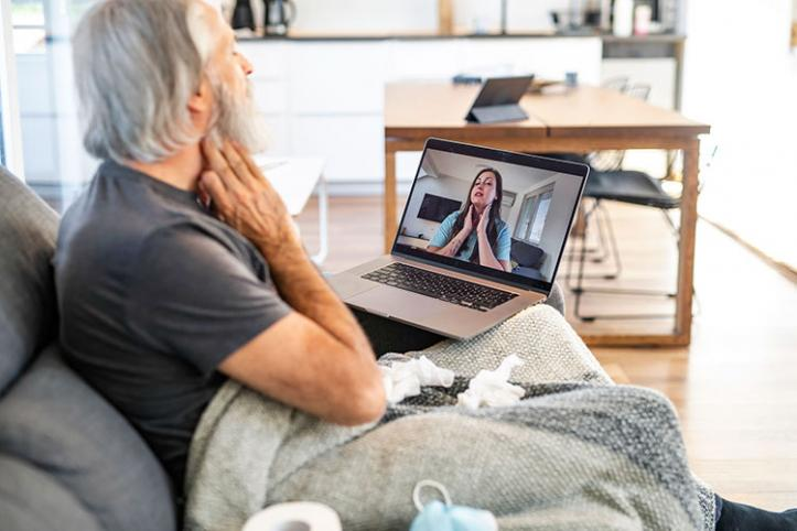 Image of person attending online GP appointment