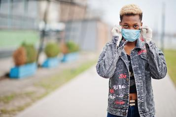 Black teenager in mask