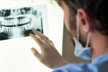 Image of dentist with xray