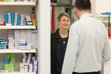 Person speaking to a pharmacist