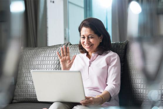 Happy Woman at Online Meeting