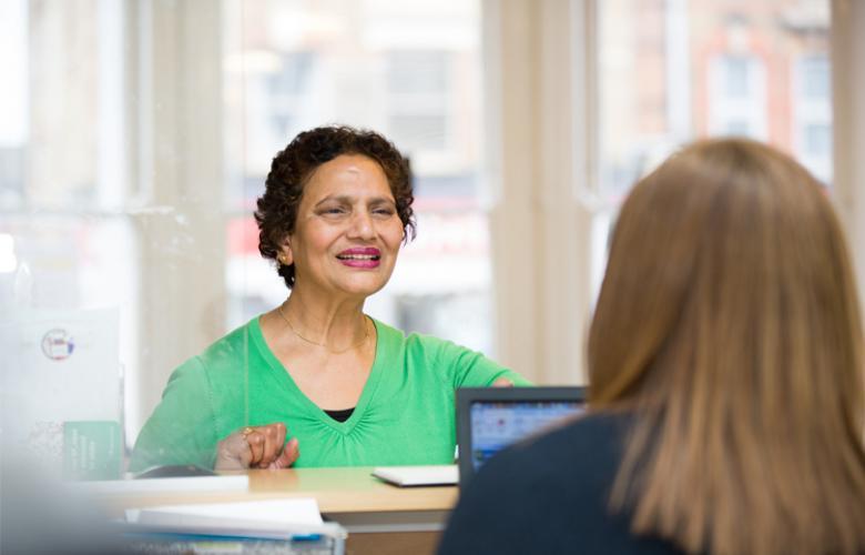 Female patient at reception desk